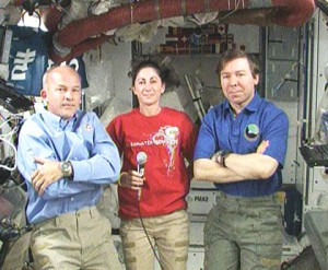 Expedition 21 Flight Engineer Jeff Williams (left) joins Expedition 20 Flight Engineers Nicole Stott (center) and Michael Barratt in answering questions from the media. Credit: NASA TV