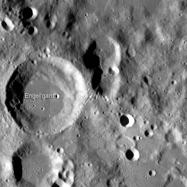 LROC WAC mosaic of region around the lunar highest point (arrow). Engel'gradt (after Vasilij Pavlovich; Russian astronomer, 1828-1915) crater is 44 km diameter, north is up, mosaic width 100 km . Credit: NASA/GSFC/Arizona State University